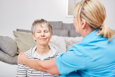 senior woman in physiotherapy together with nurse