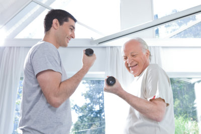 therapist having a physical therapy session with senior man