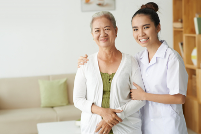 young nurse and senior woman are smiling